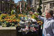 A pile of lunchtime litter is added to by a City worker outside the Bank of England during the 2018 heatwave in the City of London, the capital's historic financial district, on 2nd August 2018, in London, England.