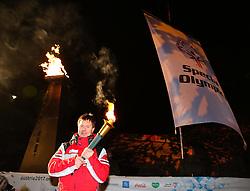 10.01.2016, Schladming, AUT, Special Olympics Pre-Games in Graz-Schladming-Ramsau, Eröffnungsfeier im WM-Park Planai, im Bild Special-Olympics-Athlet Alexander Radin (AUT) mit Flamme und Flagge // athlete Alexander Radin of Austria with fire and flag during the opening ceremony of the Special Olympics Pre-Games in Schladming, Austria on 2016/01/10. EXPA Pictures © 2016, PhotoCredit: EXPA / Martin Huber