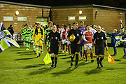 The teams enter the field during the EFL Trophy group stage match between Forest Green Rovers and U21 Arsenal at the New Lawn, Forest Green, United Kingdom on 7 November 2018.