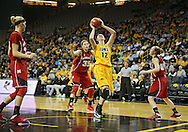 February 11 2013: Iowa Hawkeyes center Morgan Johnson (12) puts up a shot during the first half of the NCAA women's basketball game between the Nebraska Cornhuskers and the Iowa Hawkeyes at Carver-Hawkeye Arena in Iowa City, Iowa on Monday, February 11 2013.