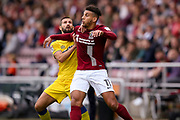 AFC Wimbledon midfielder George Francomb (7) and Northampton Town midfielder Daniel Powell (11) battle for the ball during the EFL Sky Bet League 1 match between Northampton Town and AFC Wimbledon at Sixfields Stadium, Northampton, England on 14 October 2017. Photo by Simon Davies.