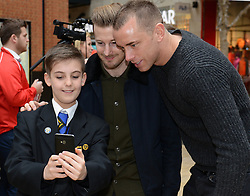 A Bristol City fan takes a selfie with Bristol City's Wade Elliott and Bristol City's Aaron Wilbraham - Photo mandatory by-line: Dougie Allward/JMP - Mobile: 07966 386802 - 11/03/2015 - SPORT - Football - Bristol - Cabot Circus Shopping Centre - Johnstone's Paint Trophy