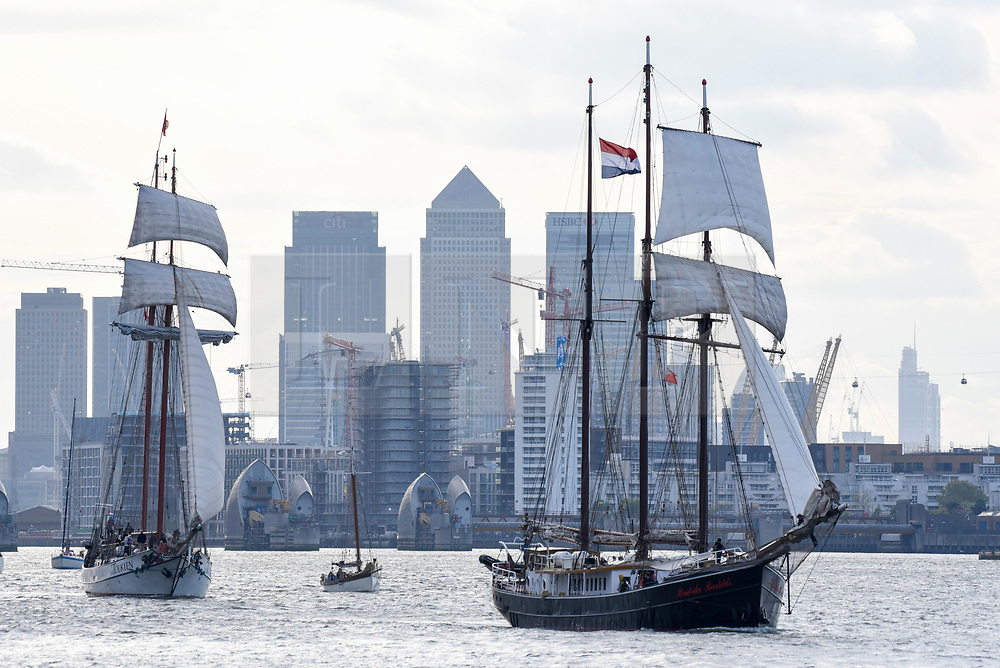 © Licensed to London News Pictures. 16/04/2017. London, UK. (L to R) TS JR Tolkein and TS Hendrika Bartelds pass by.  More than 30 ships from around the world take part in the Parade of Sail, the culmination of the Royal Greenwich Tall Ships Festival 2017.  Greenwich also marks the start of the Rendez-Vous 2017 Tall Ships Regatta, where these ships will journey to Quebec to mark the 150th anniversary of the Canadian Confederation. Photo credit : Stephen Chung/LNP