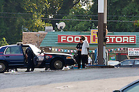 Atlanta Police Department officers detain a man during sweeps in the Bowen Homes public housing project on Saturday, August 18, 2007. Police said they found drugs, drug money and at least one stolen car during the sweeps, which also included Vine City Terrace Apartments.