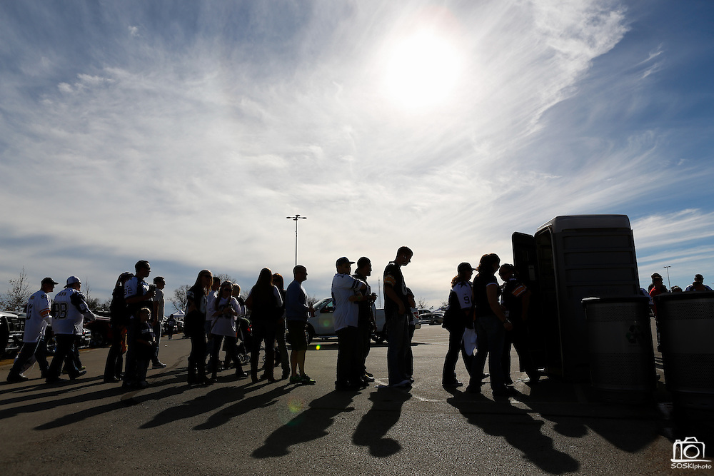 Tailgaters wait in line to use the porta-potty in parking lot 4 before the Cowboys host the Steelers at Cowboys Stadium in Arlington, Texas, on December 16, 2012.  (Stan Olszewski/The Dallas Morning News)