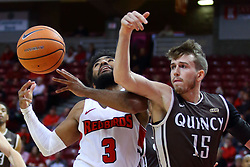 22 November 2017:  Keyshawn Evans takes an elbow from Trevor Meny during a College mens basketball game between the Quincy Hawks and Illinois State Redbirds in  Redbird Arena, Normal IL
