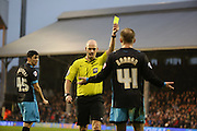Referee Kevin Johnson giving Sheffield Wednesday midfielder Barry Bannan a yellow card during the Sky Bet Championship match between Fulham and Sheffield Wednesday at Craven Cottage, London, England on 2 January 2016. Photo by Matthew Redman.