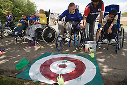 Children with physical disabilities playing target games,