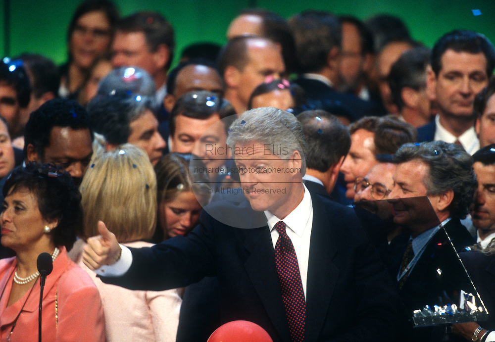 U.S President Bill Clinton gives a thumbs up as confetti falls after he accepts the presidential nomination for the democrat party at the 1996 Democratic National Convention August 29, 1996 in Chicago, IL.