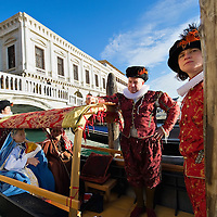 VENICE, ITALY - DECEMBER 26:  Rowers dressed in XVI century costumes escort a live nativity scene, whilst ferrying them in a gondola from St Mark's to the Island of S Giorgio on December 26, 2011 in Venice, Italy.  The event is in its first year wants and to replicate an ancient tradition when the Doge of Venice used to go to the Island of S Giorgio to celebrate the relics of Santo Stefano on Boxing Day. HOW TO LICENCE THIS PICTURE: please contact us via e-mail at sales@xianpix.com or call our office London   +44 (0)207 1939846 for prices and terms of copyright. First Use Only ,Editorial Use Only, All repros payable, No Archiving.© MARCO SECCHI