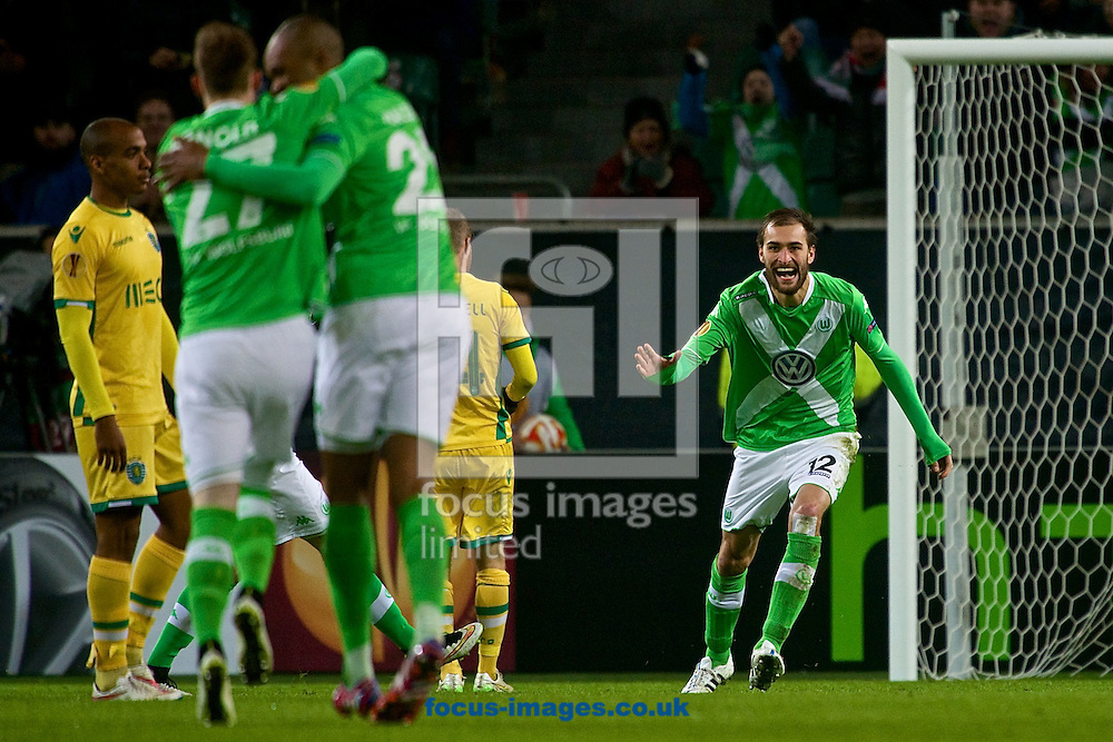 Bas Dost of VfL Wolfsburg (right) celebrates scoring their first goal to make it VfL Wolfsburg 1  Sporting Clube de Portugal 0 during the UEFA Europa League match at Volkswagen Arena, Wolfsburg<br /> Picture by Ian Wadkins/Focus Images Ltd +44 7877 568959<br /> 19/02/2015