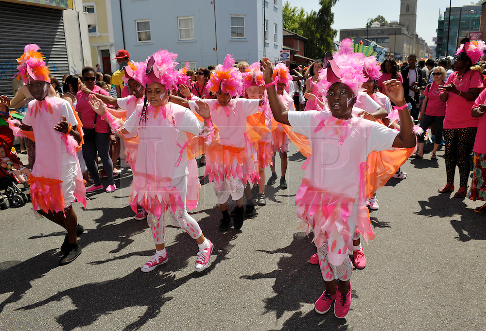 © Licensed to London News Pictures. 06/07/2013. Bristol, UK. St Pauls Carnival, an annual celebration of culture in the heart of Bristol's Afro-Caribbean community.  The theme this year was migration.  School children take part in the procession with some wearing Empire Windrush hats to denote the ship that brought migrants from the Caribbean to work in the UK.  06 July 2013.<br /> Photo credit : Simon Chapman/LNP