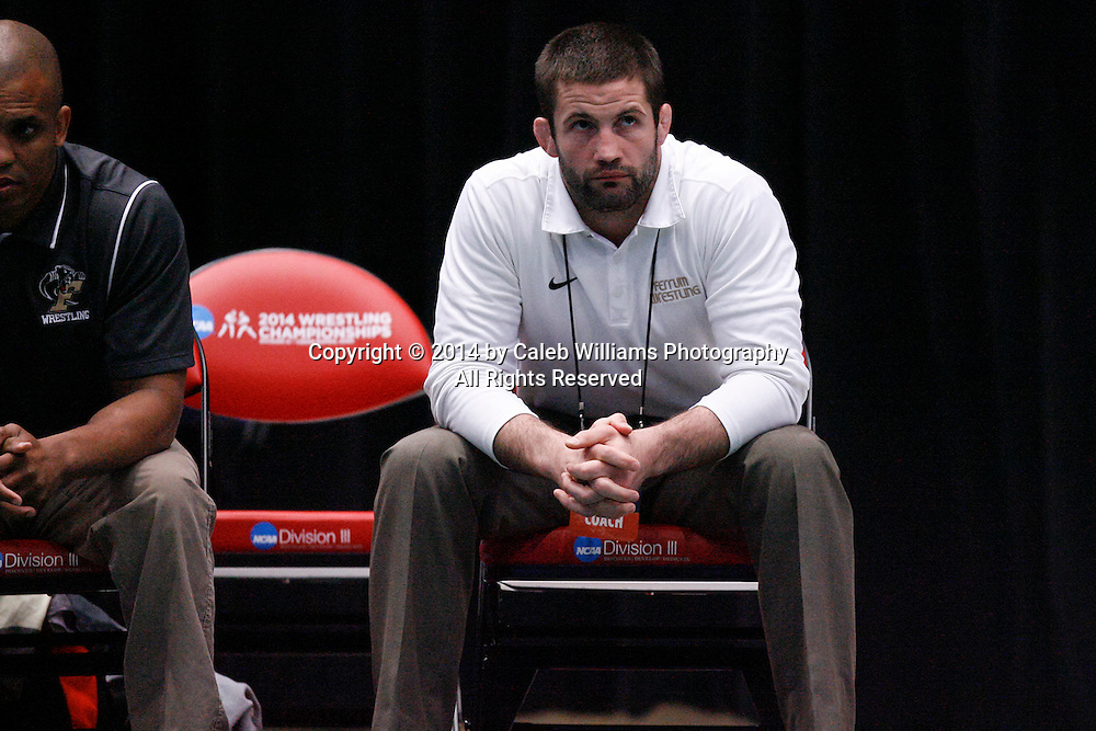 NCAA Division III Wrestling National Championships<br /> Session II<br /> <br /> CEDAR RAPIDS, Iowa (Feb. 14, 2014) -- Ferrum Head Coach Nate Yetzer watches action between Ferrum's Logan Meister and Mount Union's Bryant Roby at the 2014 NCAA Div. III Wrestling National Championships. Meister won the match 6-1 in sudden victory 1.