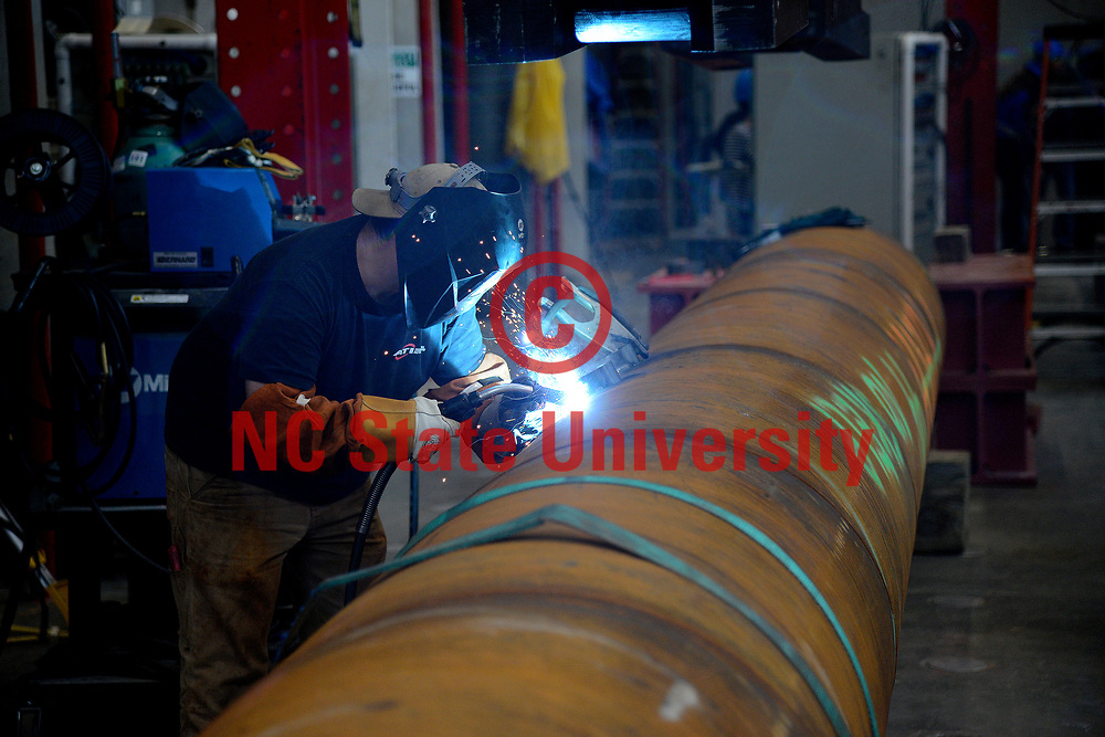 Welding occurs in the Constructed Facilities Lab on the Centennial Campus of North Carolina State University. Photo by Marc Hall/NC State