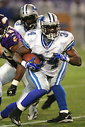 MINNEAPOLIS - NOVEMBER 21:  Rookie running back Kevin Jones #34 of the Detroit Lions rushed for 100 yards against the Minnesota Vikings at the Hubert H. Humphrey Metrodome on November 21, 2004 in Minneapolis, Minnesota. The Vikings defeated the Lions 22-19. ©Paul Anthony Spinelli  *** Local Caption *** Kevin Jones