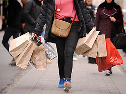 "File photo dated 06/12/11 of a lady carrying shopping bags. Retail sales were flat in May after a strong April as financially pressed households led to ""tepid"" trading conditions, figures show."