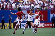 FIFA World Cup - USA 1994<br /> 10.7.1994, Giants Stadium, New York/New Jersey.<br /> World Cup Quarter Final, Bulgaria v Germany.<br /> Guido Buchwald (Germany) v Zlatko Yankov & Nasko Sirakov (Bulgaria).