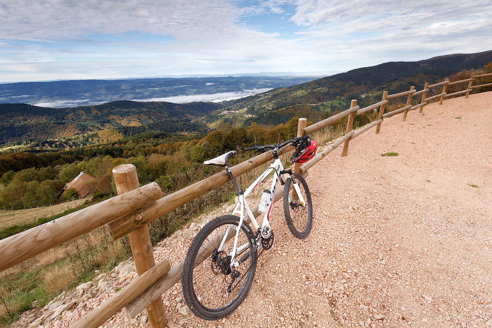 Mountain bike at viewing point  over the valley