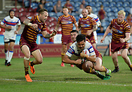 Justin Horo of Wakefield Trinity dives over to score during the Betfred Super League match at the John Smiths Stadium, Huddersfield<br /> Picture by Richard Land/Focus Images Ltd +44 7713 507003<br /> 27/07/2018