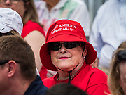 "11 JUNE 2019 - COUNCIL BLUFFS, IOWA: A woman wearing a ""Make America Great Again"" bucket hat waits to see President Trump at Southwest Iowa Renewable Energy. President Trump visited Southwest Iowa Renewable Energy in Council Bluffs Tuesday to announce that his administration was relaxing rules on E15, an ethanol additive for gasoline. Iowa is one of the leading ethanol producers in the U.S. and Iowa corn farmers hope the administration's change in E15 rules will spur demand for corn.          PHOTO BY JACK KURTZ"