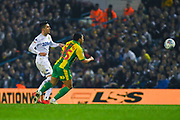 Pablo Hernandez of Leeds United (19) passes the ball away from Jefferson Montero of West Bromwich Albion (15) during the EFL Sky Bet Championship match between Leeds United and West Bromwich Albion at Elland Road, Leeds, England on 1 March 2019.