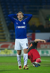 CARDIFF, WALES - Tuesday, February 1, 2011: Cardiff City's Michael Chopra shows his frustration at missing a golden chance during the Football League Championship match at the Cardiff City Stadium. (Photo by Gareth Davies/Propaganda)