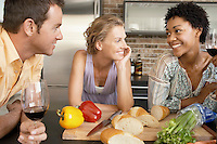 Friends talking while preparing dinner portrait