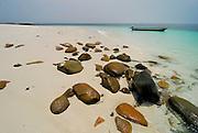 Canoe with outboard motor at the beach in Chapera island. Las Perlas archipelago, Panama province, Panama, Central America.
