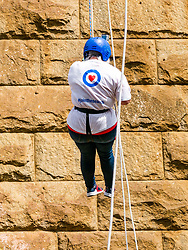 Pictured: Charity Abseil. Forth Rail Bridge, South Queensferry, Scotland, United Kingdom, {ipOver 450 people abseil from the Forth Rail Bridge deck down to the the beach to raise money for a number of Scottish charities, including Scottish SPCA, Chest, Heart & Stroke Scotland, Riding for the Disabled & Brain Tumour Research.<br /> <br /> Sally Anderson | EdinburghElitemedia.co.uk