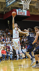 MOON TOWNSHIP, PA - NOVEMBER 11:  Braden Burke #5 of the Robert Morris Colonials puts up a shot over AJ Brodeur #25 of the Pennsylvania Quakers in the second half during the game on November 11, 2016, at the Charles L. Sewall Center in Moon Township, Pennsylvania. (Photo by Justin Berl)