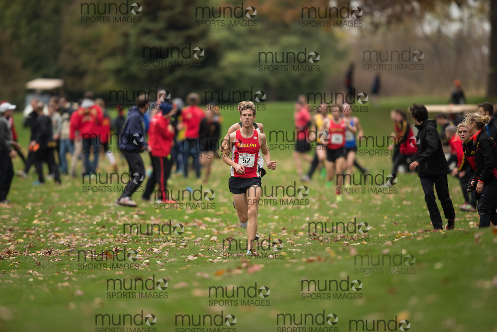 Aaron Hendrikx of the Guelph Gryphons runs in the men's  10K Run at the 2013 CIS Cross Country Championships in London Ontario, Saturday,  November 9, 2013.<br /> Mundo Sport Images/ Geoff Robins