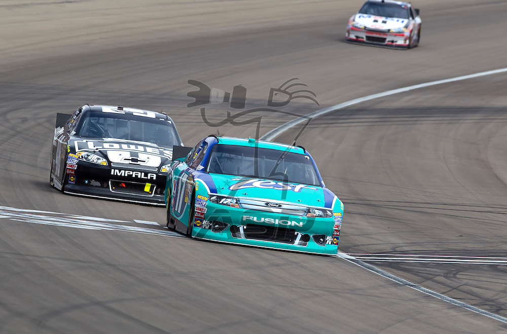 LAS VEGAS, NV - MAR 11, 2012:  Matt Kenseth (17) and Jimmie Johnson (48) battle for position during the Kobalt Tools 400 race at the Las Vegas Motor Speedway in Las Vegas, NV.