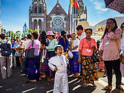 30 NOVEMBER 2017 - YANGON, MYANMAR: A boy in a Pope costume yawns during the Papal Mass at St. Mary's Cathedral in Yangon. Thursday's mass was his last public appearance in Myanmar. From Myanmar the Pope went on to neighboring Bangladesh.   PHOTO BY JACK KURTZ