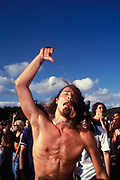Long-haired, bearded, topless man dancing, Istanbul, Turkey, 2000s.