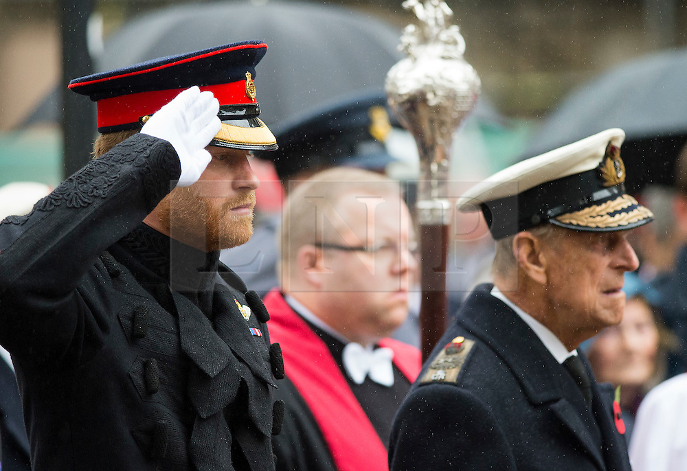 © Licensed to London News Pictures. 04/11/2015. London, UK. PRINCE HARRY salters during the service, stood next to his grandfather THE DUKE OF EDINBURGH. Service to mark the opening of the Filed of Remembrance at Westminster Abbey, attended by Prince Philip, Duke of Edinburgh and Prince Harry.  The Field of remembrance is a memorial garden to commemorate British and Commonwealth military and civilian servicemen and women in the two World Wars and later conflicts. Photo credit: Ben Cawthra/LNP