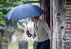 © Licensed to London News Pictures. 23/09/2018. Prime Minister THERESA MAY is pictured carrying an umbrella as she leaves a church service with her husband PHILIP, near her constituency. The PM, who will face her party at Conservative Party conference next week, demanded 'respect' from EU leaders after they rejected her Chequers plan at a recent EU summit in Salzburg, Austria. Photo credit: Ben Cawthra/LNP © Licensed to London News Pictures. 23/09/2018. Prime Minister THERESA MAY and her husband PHILIP attend a church service near her constituency. The PM, who will face her party at Conservative Party conference next week, demanded 'respect' from EU leaders after they rejected her Chequers plan at a recent EU summit in Salzburg, Austria. Photo credit: Ben Cawthra/LNP