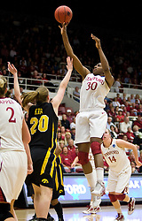 March 22, 2010; Stanford, CA, USA; Stanford Cardinal forward Nnemkadi Ogwumike (30) shoots over Iowa Hawkeyes forward Kelly Krei (20) during the second half in the second round of the 2010 NCAA womens basketball tournament at Maples Pavilion. Stanford defeated Iowa 96-67.