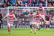George Oakley (#9) of Hamilton Academical FC runs to celebrate scoring a second goal for Hamilton during the Ladbrokes Scottish Premiership match between Heart of Midlothian FC and Hamilton Academical FC at Tynecastle Stadium, Edinburgh, Scotland on 31 August 2019.