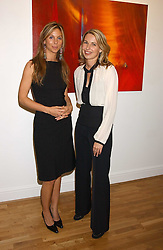 Left to right, GEORGIE LEATHAM and SERENA MORTON at an exhibition of art by Jeffrey Kroll entitled Imirage held at the Arndean Gallery, Cork Street, London on 19th October 2005.<br />