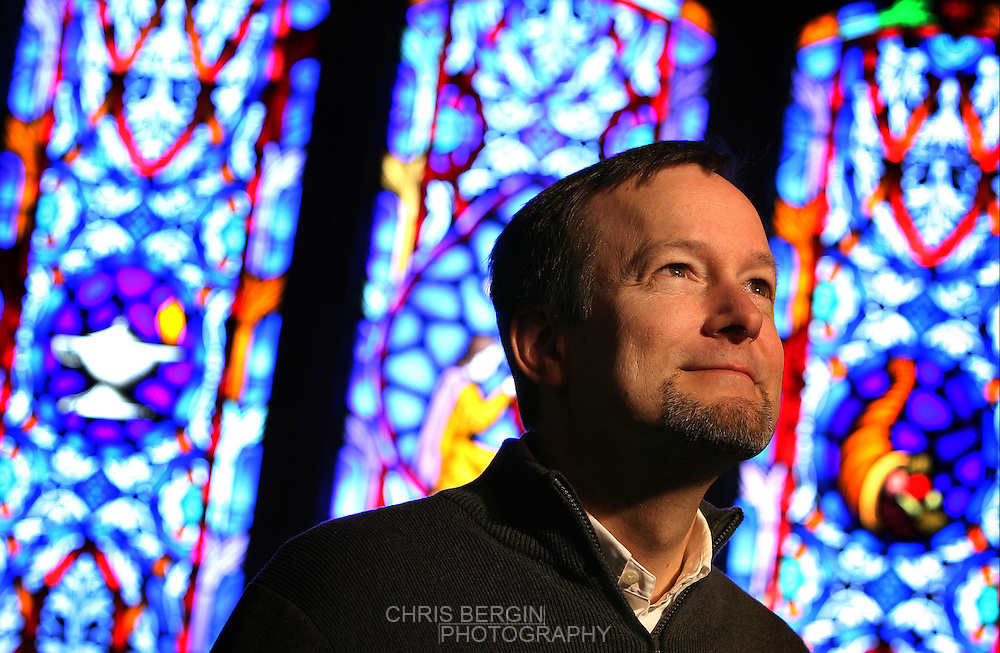 Chris Danielson, minister at High Street United Methodist Church poses in the sanctuary Friday morning. .Chris Bergin/ The Star Press