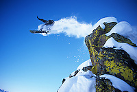 A snowboarder jumps off a cliff near Teton Pass in Jackson Hole, Wyoming.