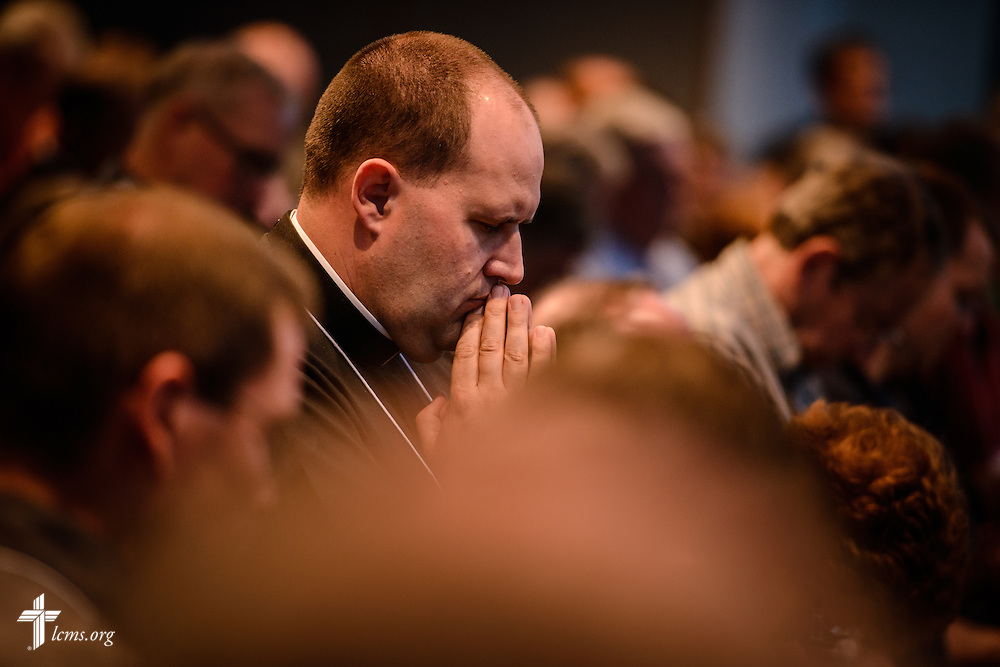 The Rev. Benjamin Ball, pastor of St. Paul Lutheran Church in Hamel, Ill., prays at worship during floor-committee weekend at the International Center of The Lutheran Church–Missouri Synod on Friday, May 27, 2016, in Kirkwood, Mo. LCMS Communications/Erik M. Lunsford