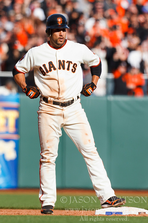 April 8, 2011; San Francisco, CA, USA;  San Francisco Giants center fielder Andres Torres (56) stands on second base after hitting a double against the St. Louis Cardinals during the eleventh inning at AT&T Park.