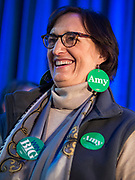 "01 FEBRUARY 2020 - DES MOINES, IOWA: ELLEN LUGER, from Minneapolis, a close friend of US Senator Amy Klobuchar (D-MN) wears ""Amy Earrings"" before a campaign event for Sen. Klobuchar. Sen. Klobuchar campaigned to support her candidacy for the US Presidency Saturday in Iowa. She is trying to capitalize on her recent uptick in national polls. Iowa holds the first selection event of the presidential election cycle. The Iowa Caucuses are Feb. 3, 2020.              PHOTO BY JACK KURTZ"