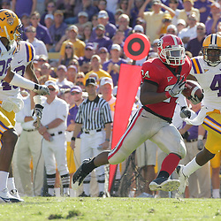 25 October 2008:  Georgia running back Knowshon Moreno (24) runs as LSU defenders Jai Eugene (4), Chris Hawkins (29), and Darry Beckwith (48) pursue during the Georgia Bulldogs 52-38 victory over the LSU Tigers at Tiger Stadium in Baton Rouge, LA.
