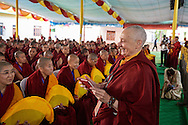 Jetsunma Tenzin Palmo with some of the twenty nuns to be awarded Geshe-ma degrees sitting in the front row in the courtyard of Drepung Lachi Monastery in Mundgod, Karnataka, India on December 22, 2016