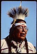 Indian man in full dance costume at folk festival in St. Louis.  Missouri