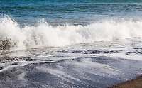 Close up of waves on Killiney Beach in Dublin Ireland