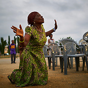 A woman in prayer. Koforidua, Ghana