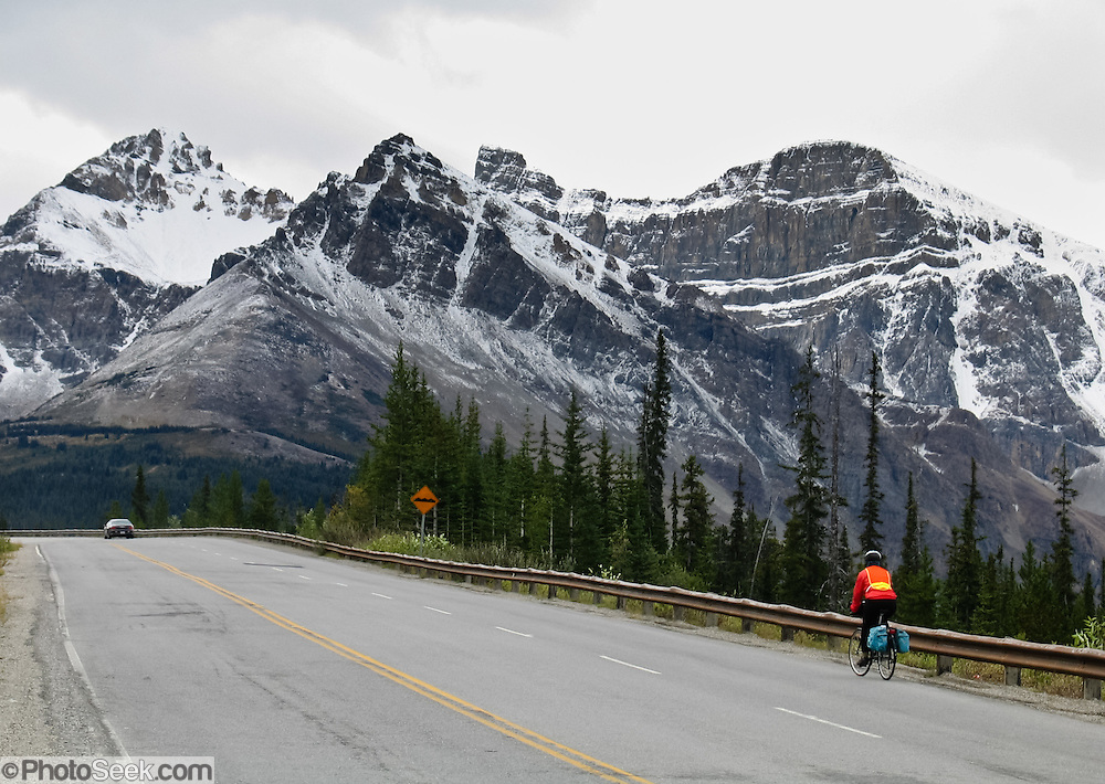 Bicycle the Icefields Parkway beneath snowy peaks in Jasper National Park, Canada. Jasper is part of the Canadian Rocky Mountain Parks World Heritage Site declared by UNESCO in 1984.